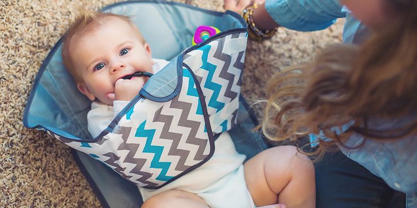 aankleedkussen voor baby verversen